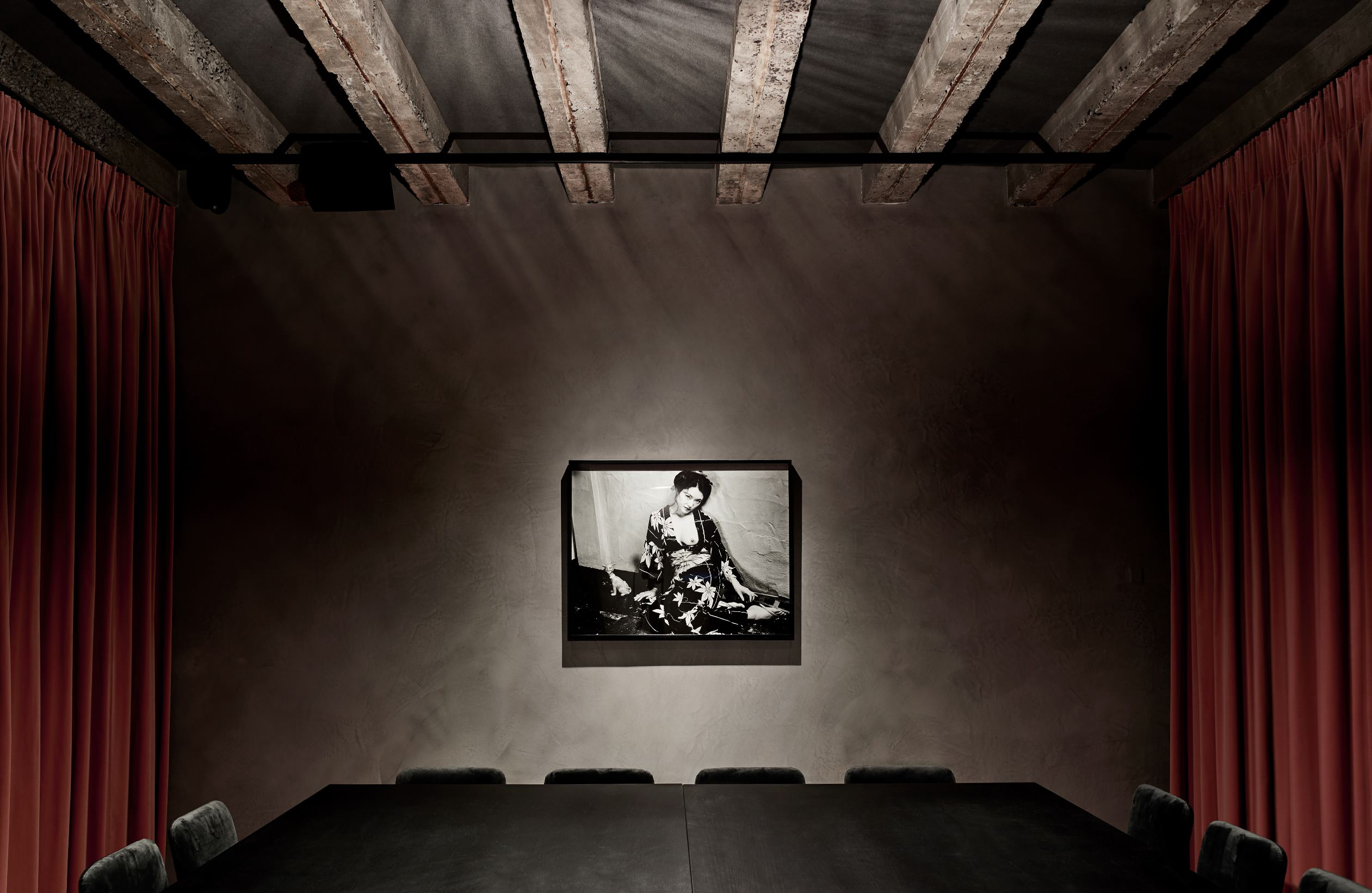 a private dining room featuring a work by Japanese contemporary photographer Nobuyoshi Araki